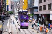 HONG KONG - JUNE 08: Public transport on the street on JUNE 08, 2015 in Hong Kong. Over 90 percent  daily travelers use public transport. Trams also a major tourist attraction. — Stockfoto