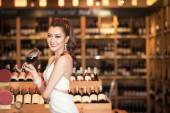 Beautiful asian woman with a glass of wine — Stock Photo