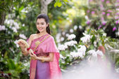 Beautiful Thai girl in Thai traditional costume — Stock Photo