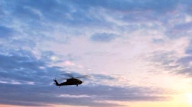 Black Hawk Helicopter Take Off silhouette in the sunse — Stock Video