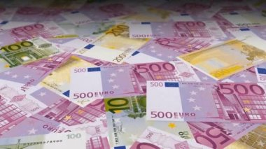 Dolly shot across a table filled with EUR bills — Stock Video