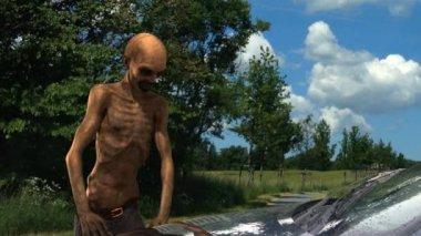 Walking dead undead zombie walks behind a car — Stock Video