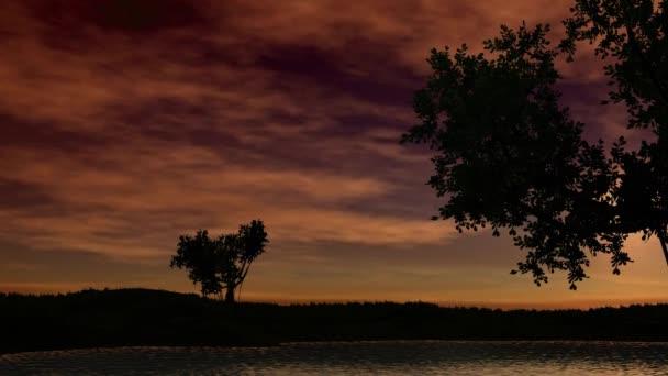 Puesta de sol sobre un lago — Vídeo de stock