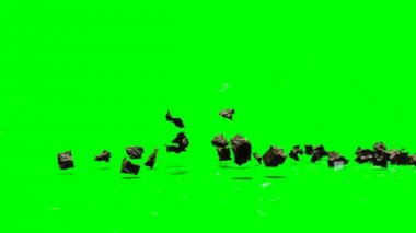 Rubble stones explode on green background — Stock Video