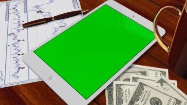 Tablet with green screen on table — Vidéo