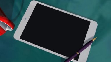 Tablet with green screen on table — Video Stock