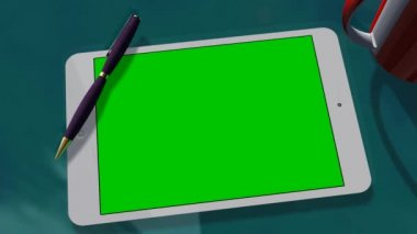 Tablet with green screen on table — Stock Video