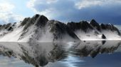 Calm waters of a glacier lake with Snowy mountains behin — Stock Photo