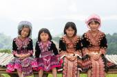 Four young girl Mhongs sit on the chair with mountain view — Stockfoto