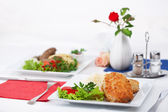 Cutlet with garnish on a table — Stock Photo