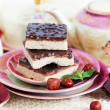 Three pieces of shortcake cake with nuts and chocolate — Stock Photo #57710441