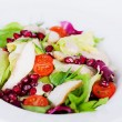 Salad with chicken, iceberg lettuce, pomegranate closeup — Stock Photo #75867249