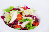 Salad with chicken, iceberg lettuce, pomegranate closeup — Stock Photo