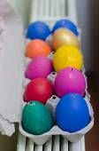 Many painted colorful easter eggs in tray — Stock Photo