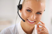 Close-up portrait of a customer service agent sitting at office — Stock Photo