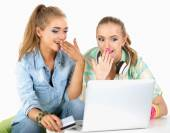 Two young women sitting with laptop  and credit cart at home — Foto de Stock