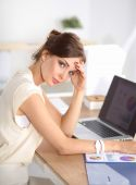Young and beautiful businesswoman tired from work in the office — Stock Photo
