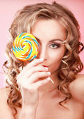 Young happy woman with lollipop — Stock Photo