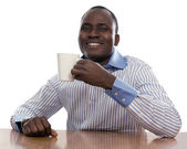 African man with cup of tea — Stock Photo