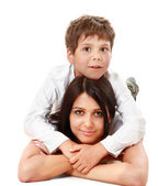 Mother and  son are lying the floor isolated on white background — Stock Photo