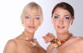 Portrait of a two beautiful women with necklace, isolated on white background — 图库照片