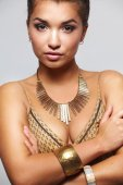 Young beautiful brunette woman with beads — Stock Photo