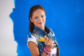 Happy beautiful young woman doing wall painting, — Stock Photo