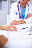 Doctor and patient sitting on the desk  at office — Stock Photo