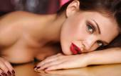 Close-up portrait of beautiful girl with trendy makeup lying — Stock Photo