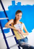 Young beautiful woman holding color palette , standing near wal — Stock Photo