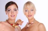Portrait of a two beautiful women with necklace, isolated on wh — Stockfoto