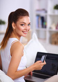 Woman shopping online with credit card and computer. — Stock Photo