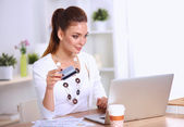 Businesswoman doing online shopping through laptop and credit c — Stock Photo