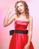 Young emotional woman, isolated on pink background — Stock Photo