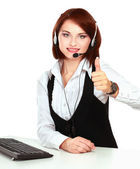 Smiling young customer service girl with a headset at her workplace, closeup, isolated on white background — Foto de Stock