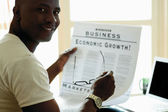 Portrait of an African American with newspaper — Stock Photo