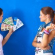 Two Young beautiful women holding color palette , standing near wall. — Stock Photo #55283873