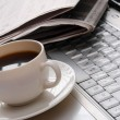 Cup of fragrant coffee on a morning paper — Stock Photo #55284345