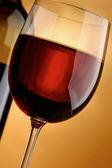 A full wineglass and a botte, closeup — Stock Photo
