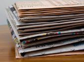 Newspaper stack on the desk. — Stockfoto