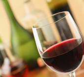 Glass of red wine and the wine bottle. — Stock Photo