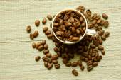 A cup and coffee beans, from above — Stock Photo