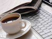 Cup of fragrant coffee on a morning paper — Foto de Stock