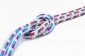 A rope with a knot on white — Stock Photo