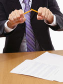 Angry businessman breaking pencil isolated — Stock Photo