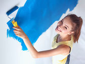 Happy beautiful young woman doing wall painting, standing — Stok fotoğraf