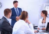 Business people sitting and discussing at business meeting, in office — Stock fotografie