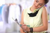 Pretty fashion designer working in office using mobile phone — Stock Photo