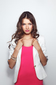 Young woman wearing a pink dress standing — Stock Photo