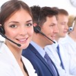 Attractive Smiling positive young businesspeople and colleagues in a call center office — Stock Photo #59232599